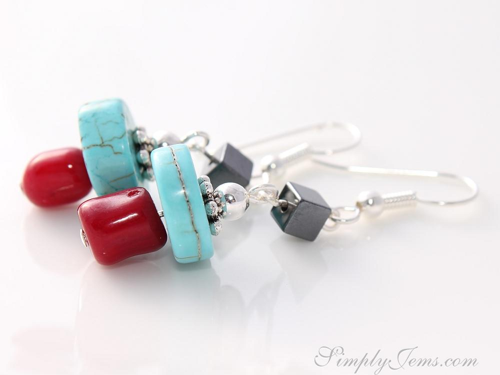 Handmade turquoise, red coral and hematite earrings with silver-plated findings.